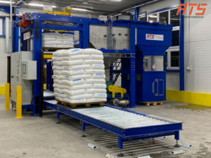 Bag emptying with automatic pallet transport and empty bag compactor (1)